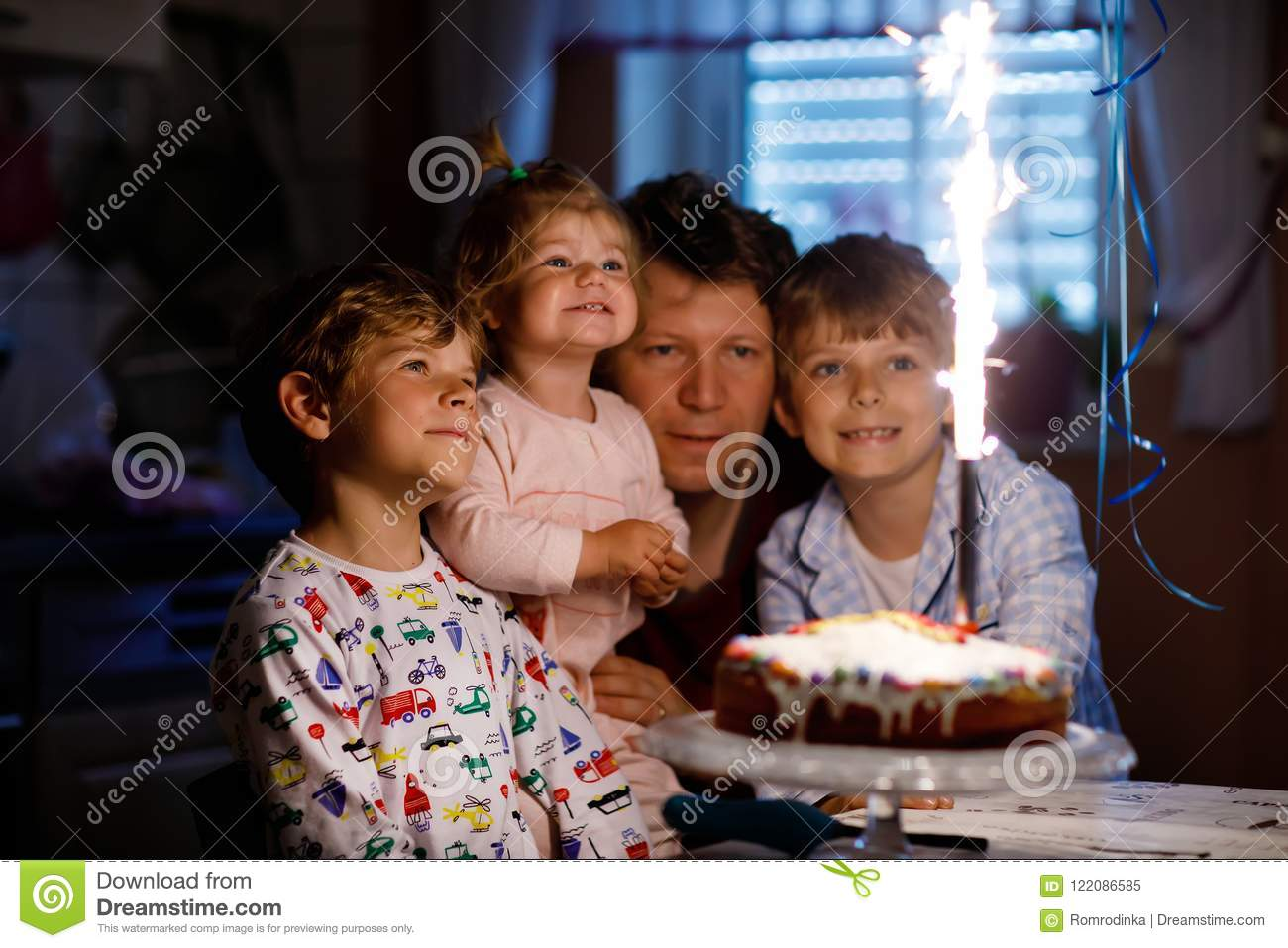 Little kid boy and family, father, brother and baby sister celebrating birthday