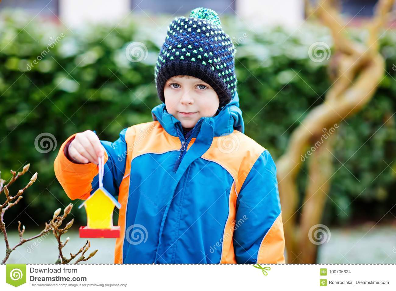 Miraculous Little Kid Boy Hanging Bird House On Tree For Feeding In Download Free Architecture Designs Scobabritishbridgeorg