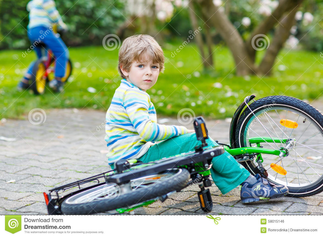 Little Kid Boy Fell Down Of His First Bike Stock Photo ...