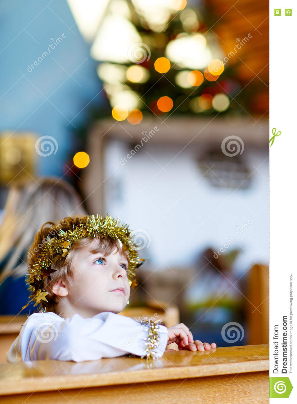 Little kid boy playing an angel of Christmas story in church