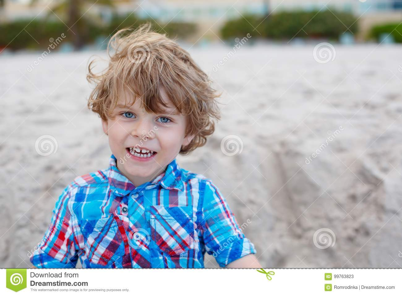 6f018ee23 Portrait of happy little kid boy on the beach of ocean. Funny cute child  making vacations and enjoying summer. Blond preschool child on beach of  Miami, ...