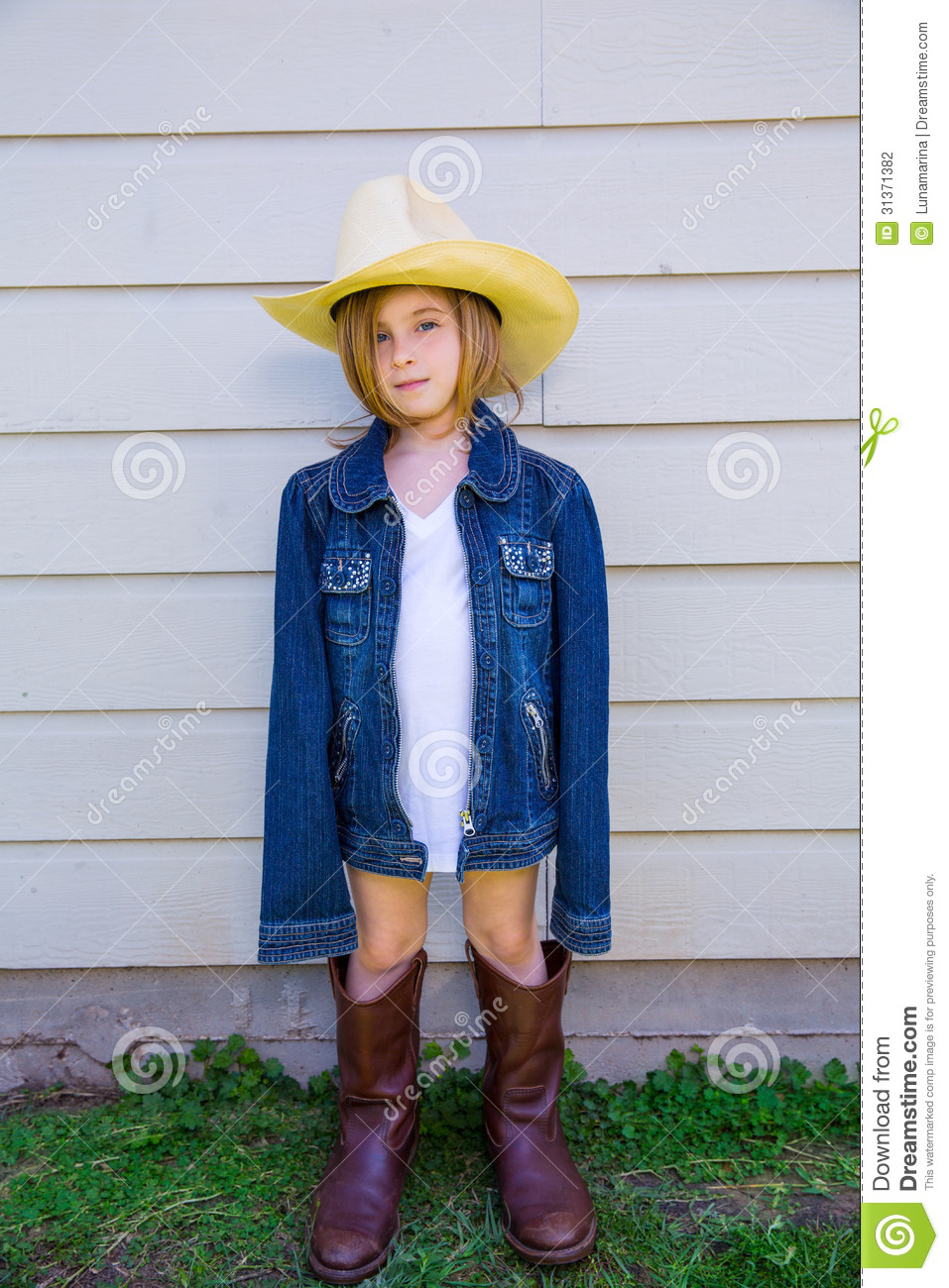 Little Kid Girl Pretending To Be A Cowboy Stock