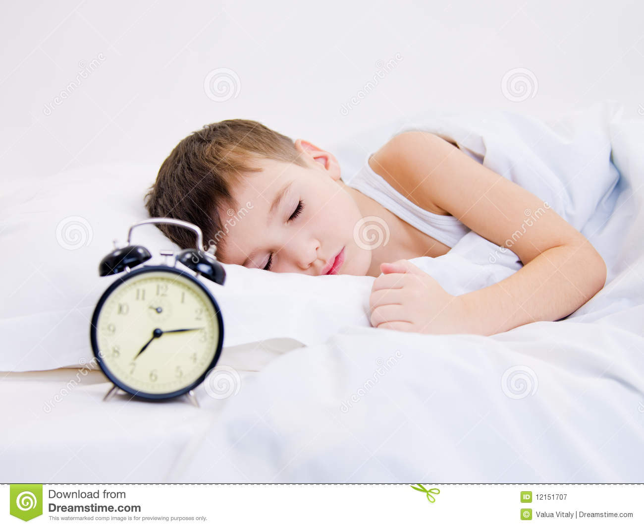 little kid sleeping with clock near his head royalty free stock photography image 12151707. Black Bedroom Furniture Sets. Home Design Ideas