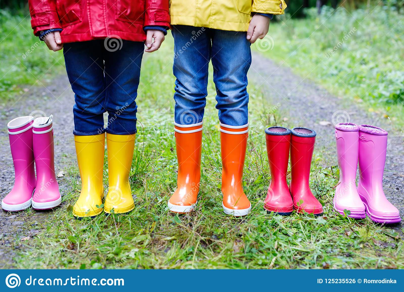 589edbdf62ad Children standing in autumn forest. Close-up of schoolkids and different  rubber boots. Footwear and fashion for rainy fall.