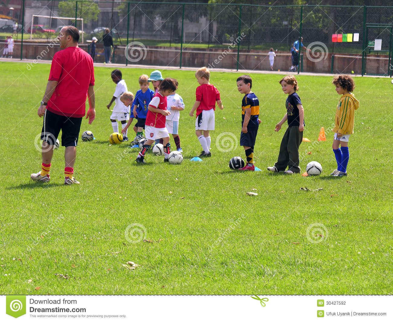Little Kids On Football Training In The Park Editorial