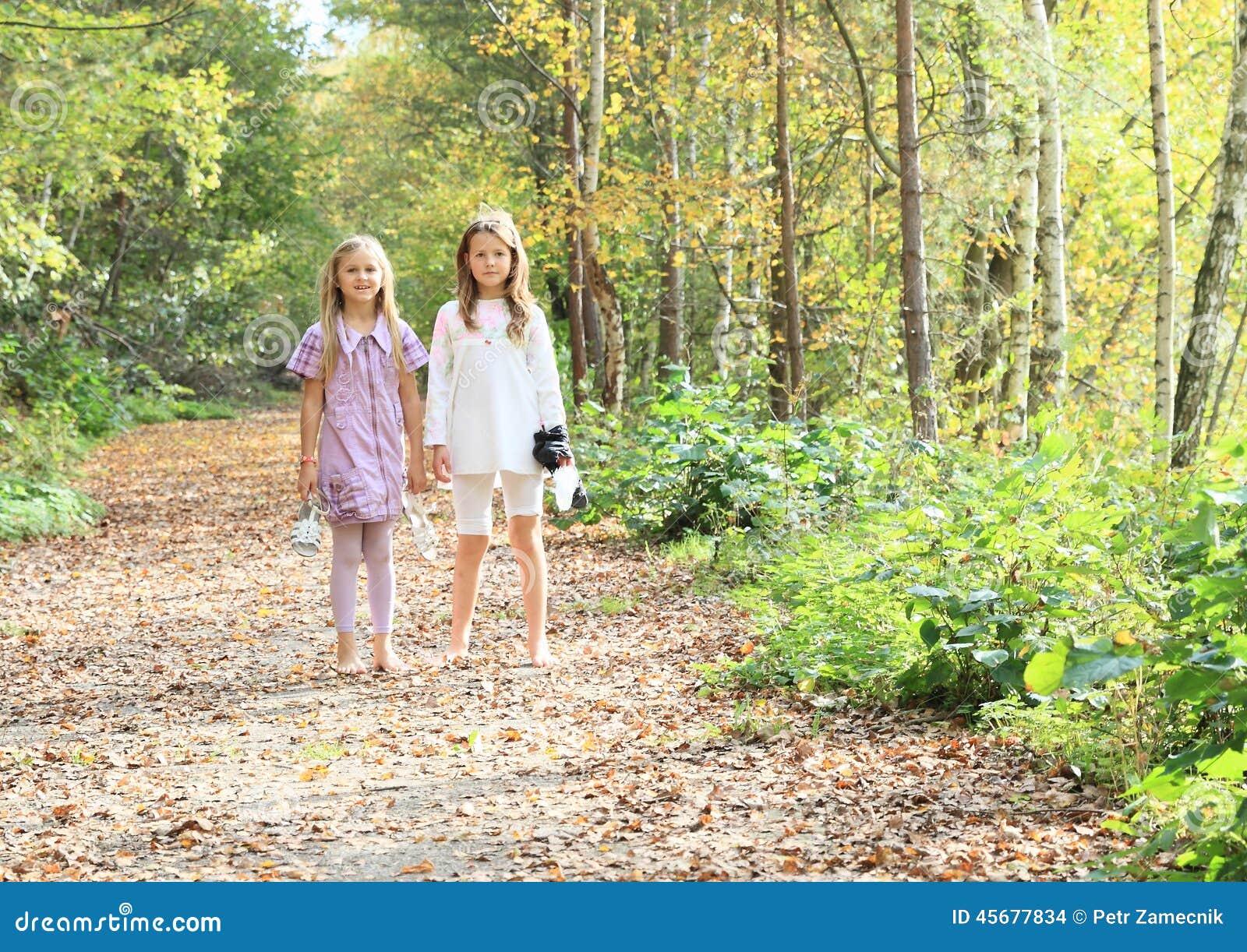 Little kids - girls standing barefoot