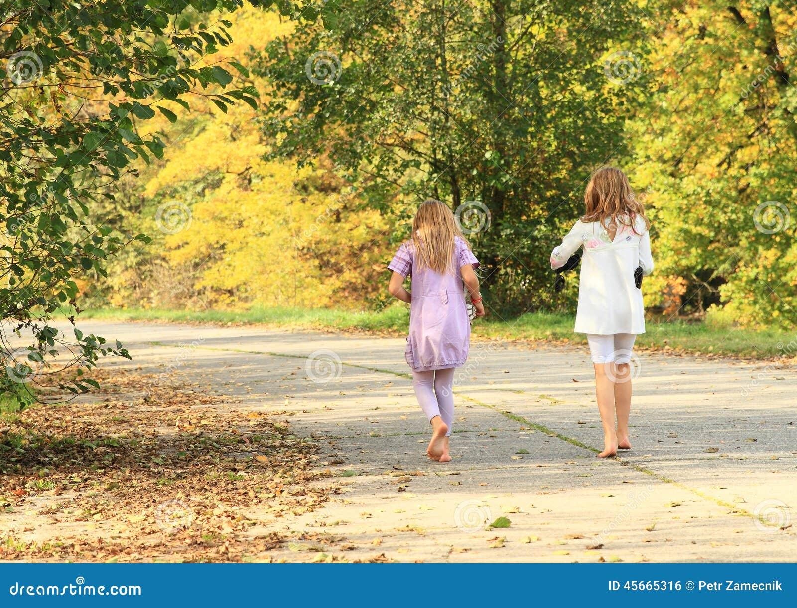 Little kids - girls walking barefoot