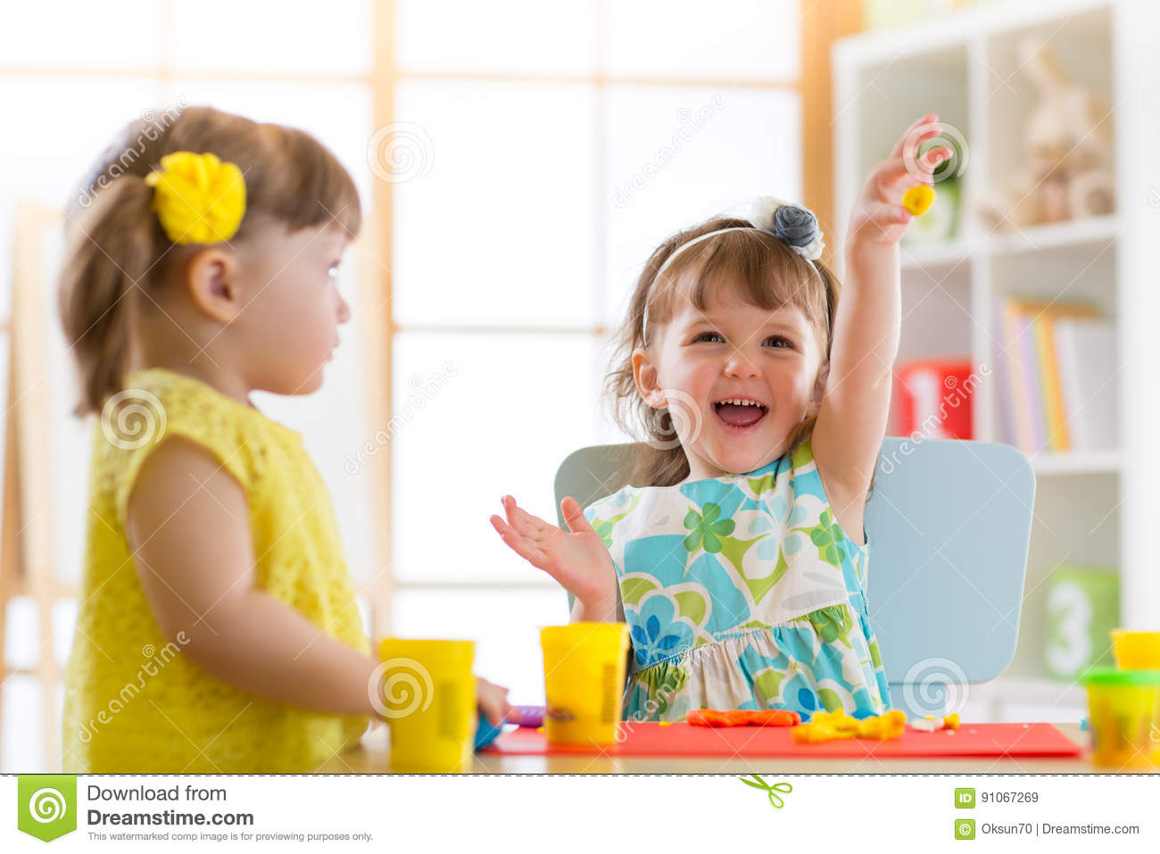Little Kids Having Fun Together With Colorful Modeling