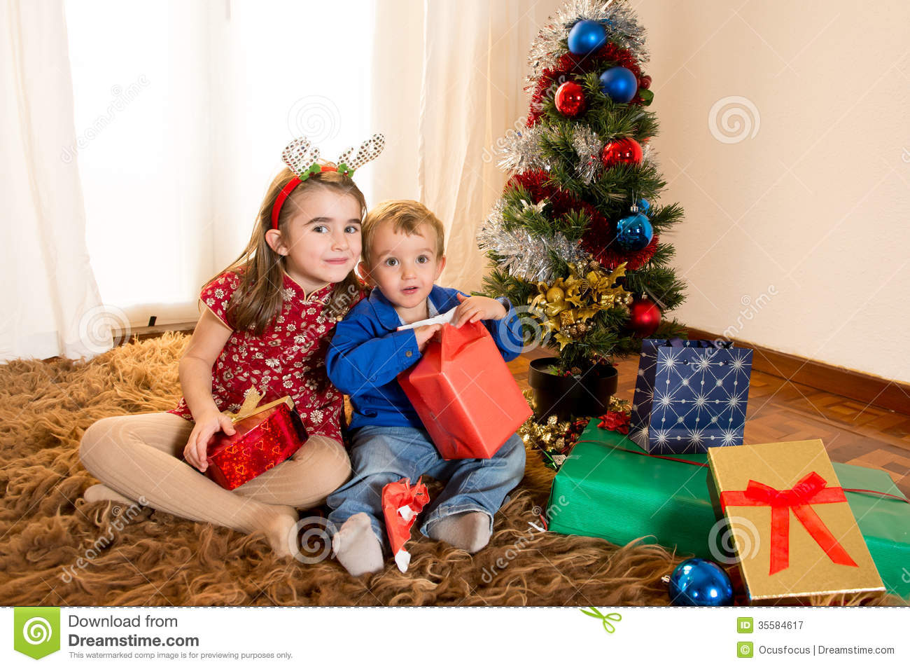 Little Kids On Rug Opening Christmas Presents Royalty Free Stock ...
