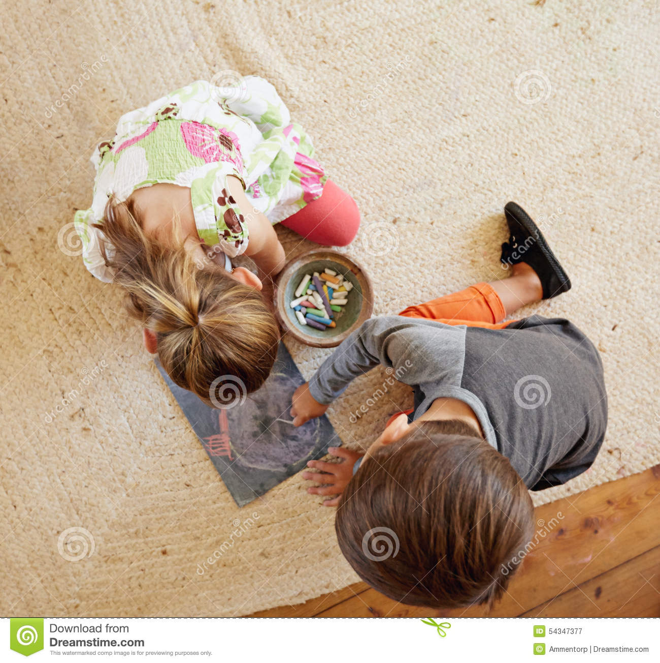 Little Kids Sitting On Floor Drawing With Color Chalks Stock