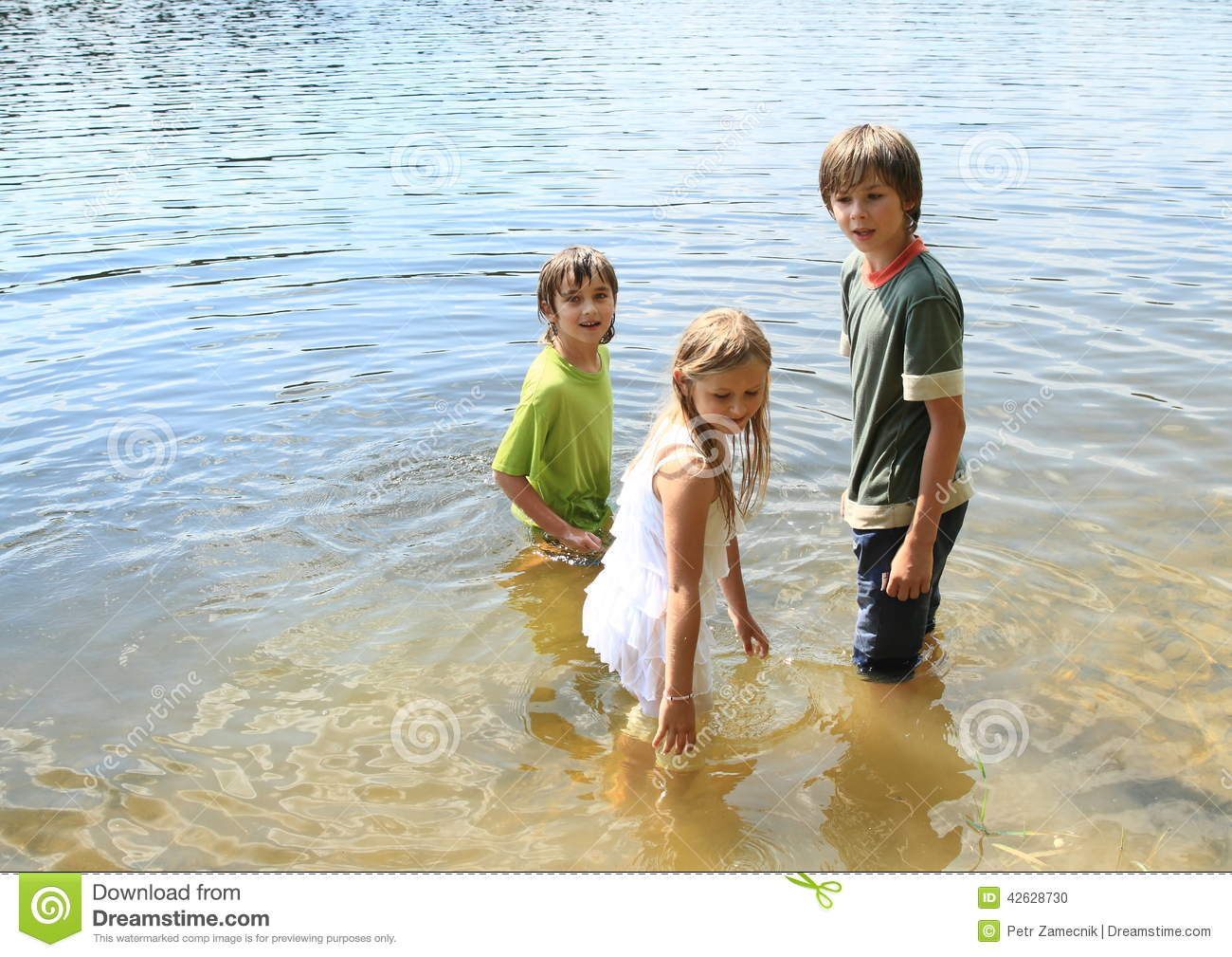 Little Kids In Water Stock Photo - Image: 42628730
