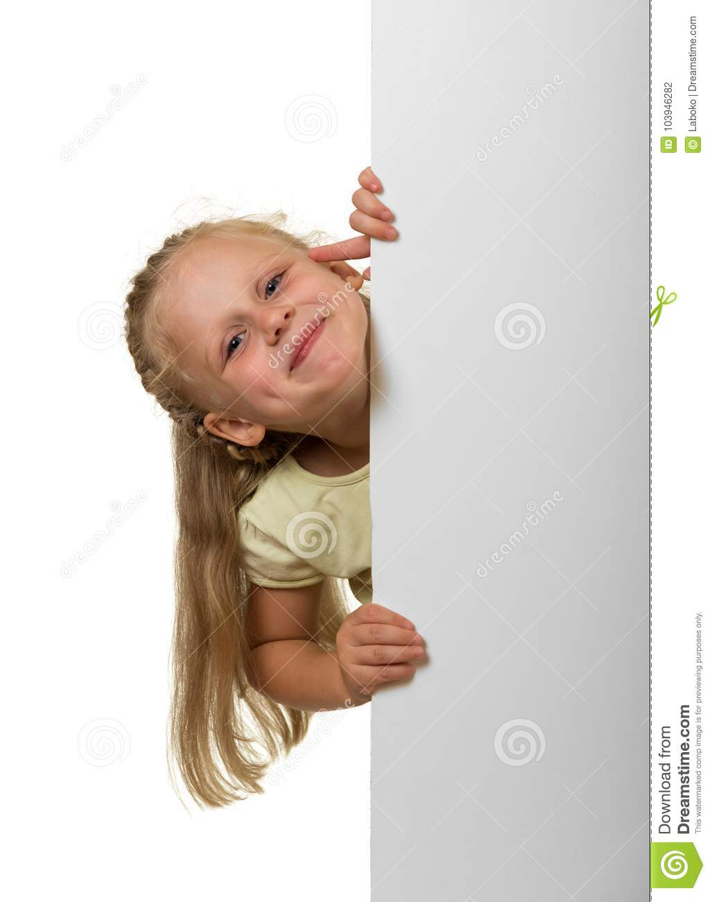 Little laughing girl peeking out from behind an empty banner, is