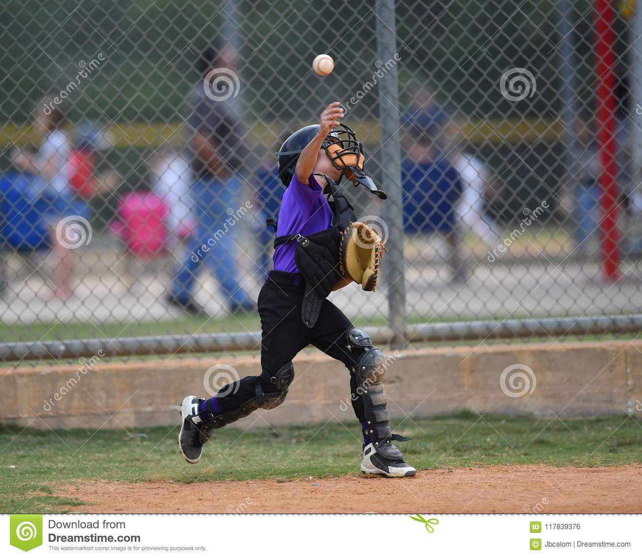 Young boy playing Little League Baseball