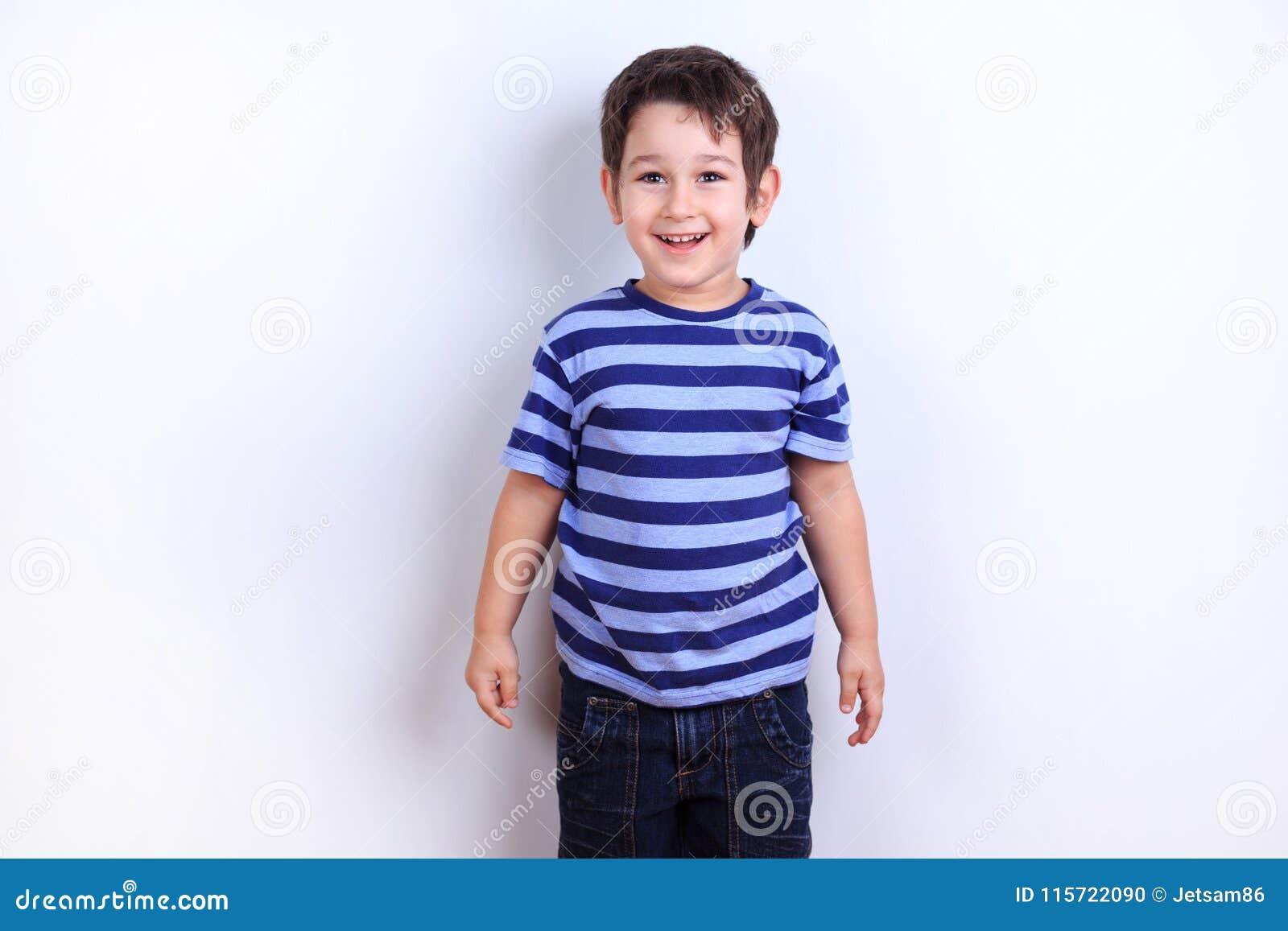 Little lovely boy laughing, studio shoot on white. Emotions, fee
