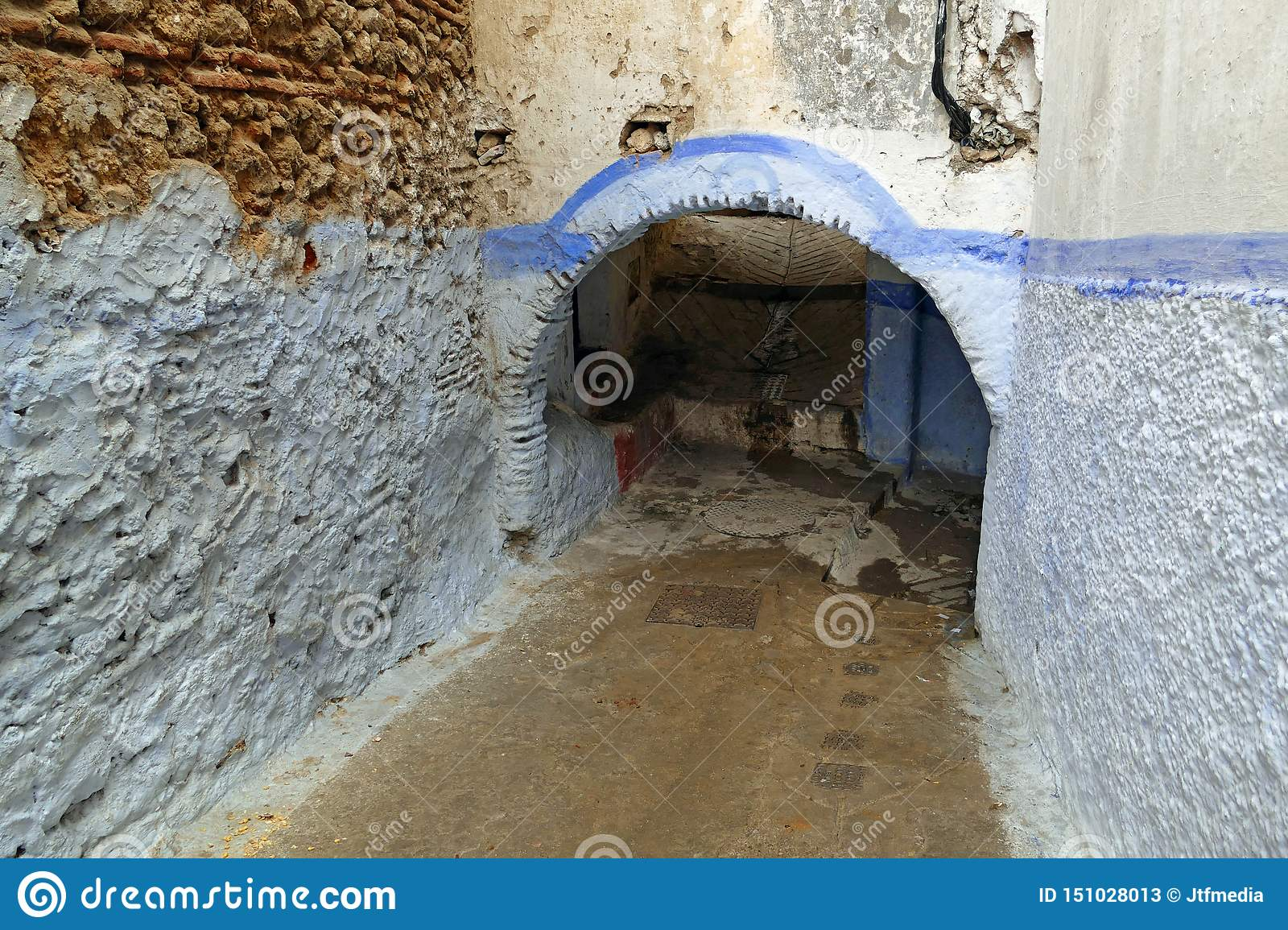 Little narrow alley with a passage in the colorful medina of Tétouan