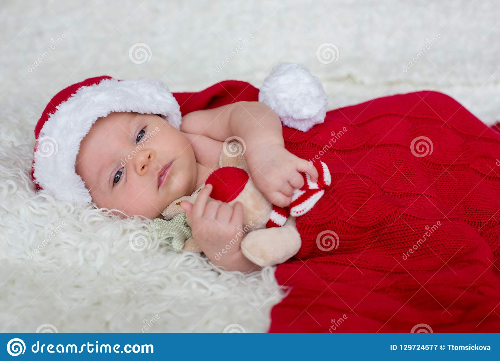 204a1bdb7 Little Newborn Baby Boy, Wearing Santa Hat Stock Image - Image of ...