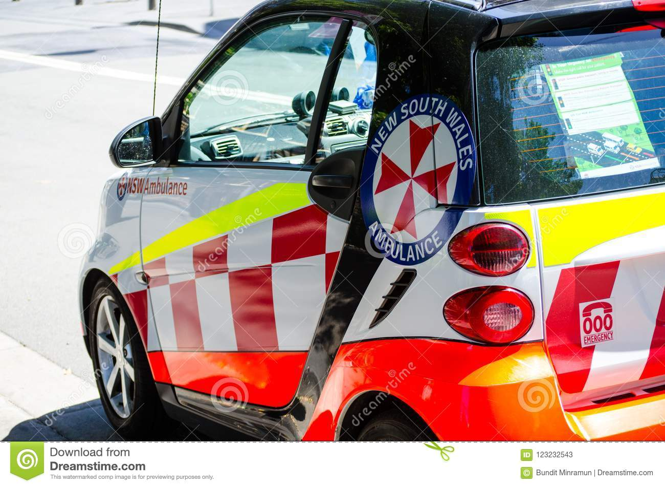 Little NSW Ambulance Smart Car Parking On Downtown Street Of