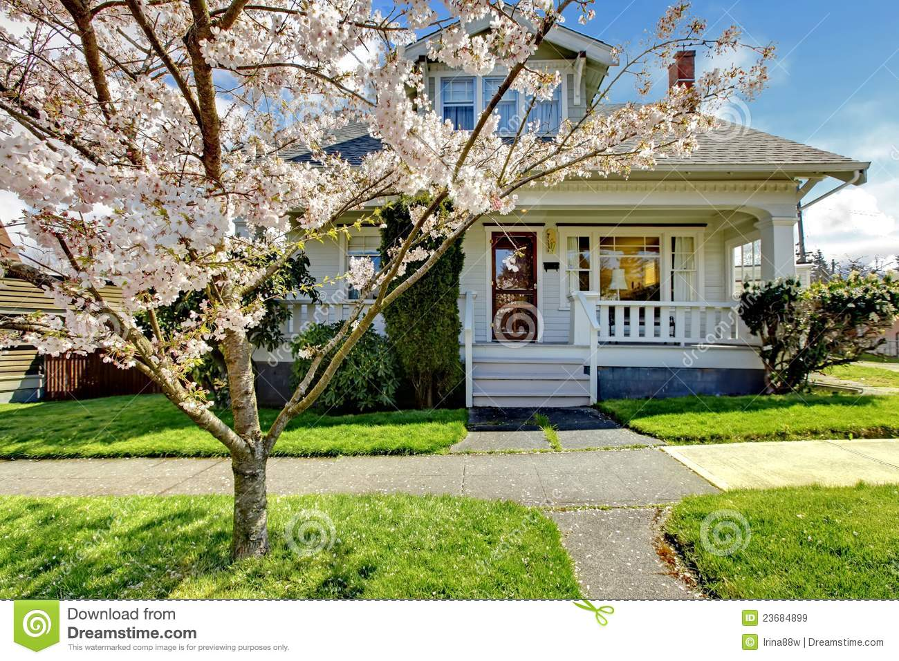 Little old cute house with a blooming cherry tree royalty for Cute house images