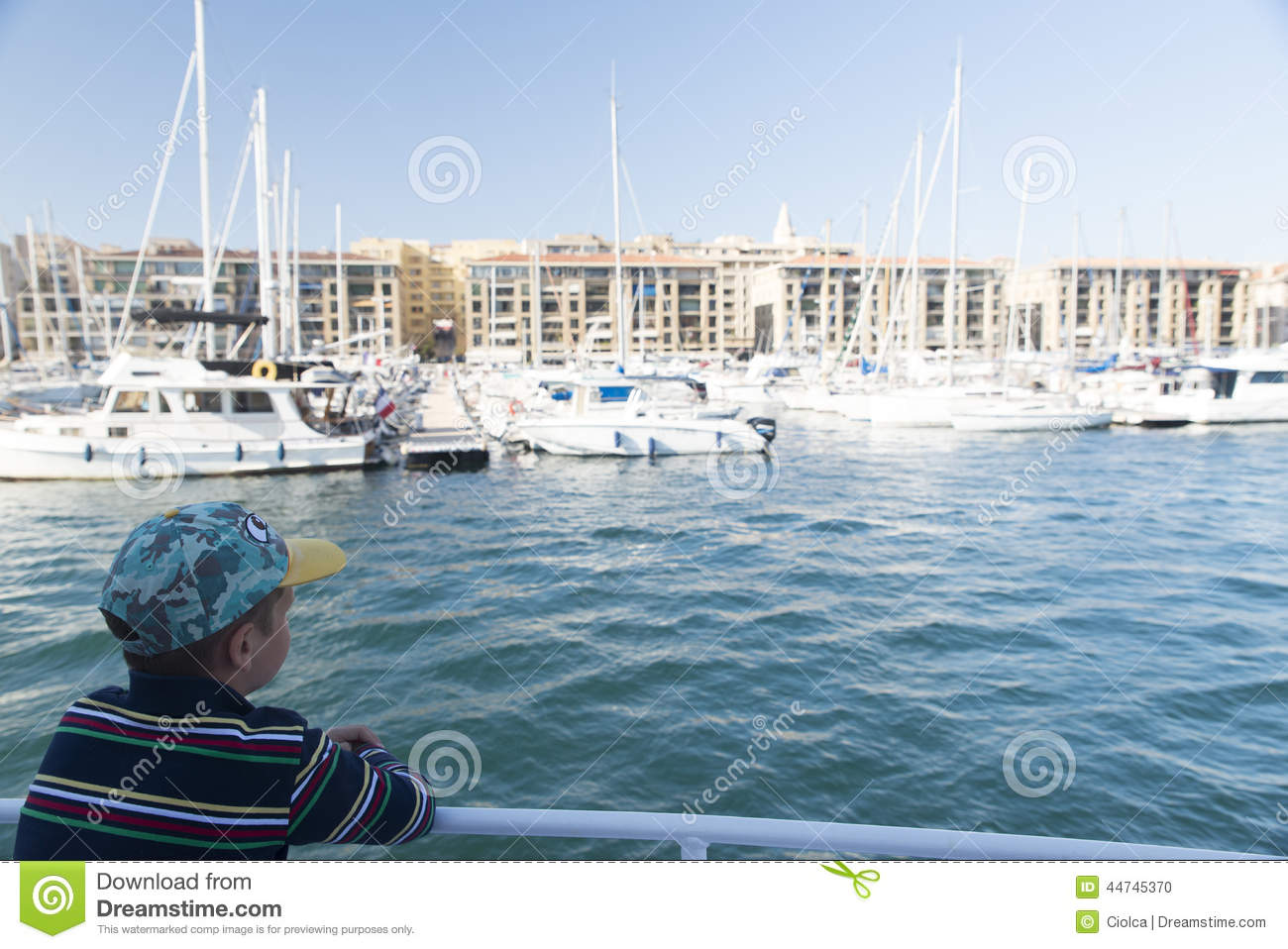 Little boy in the Old Port of Marseille