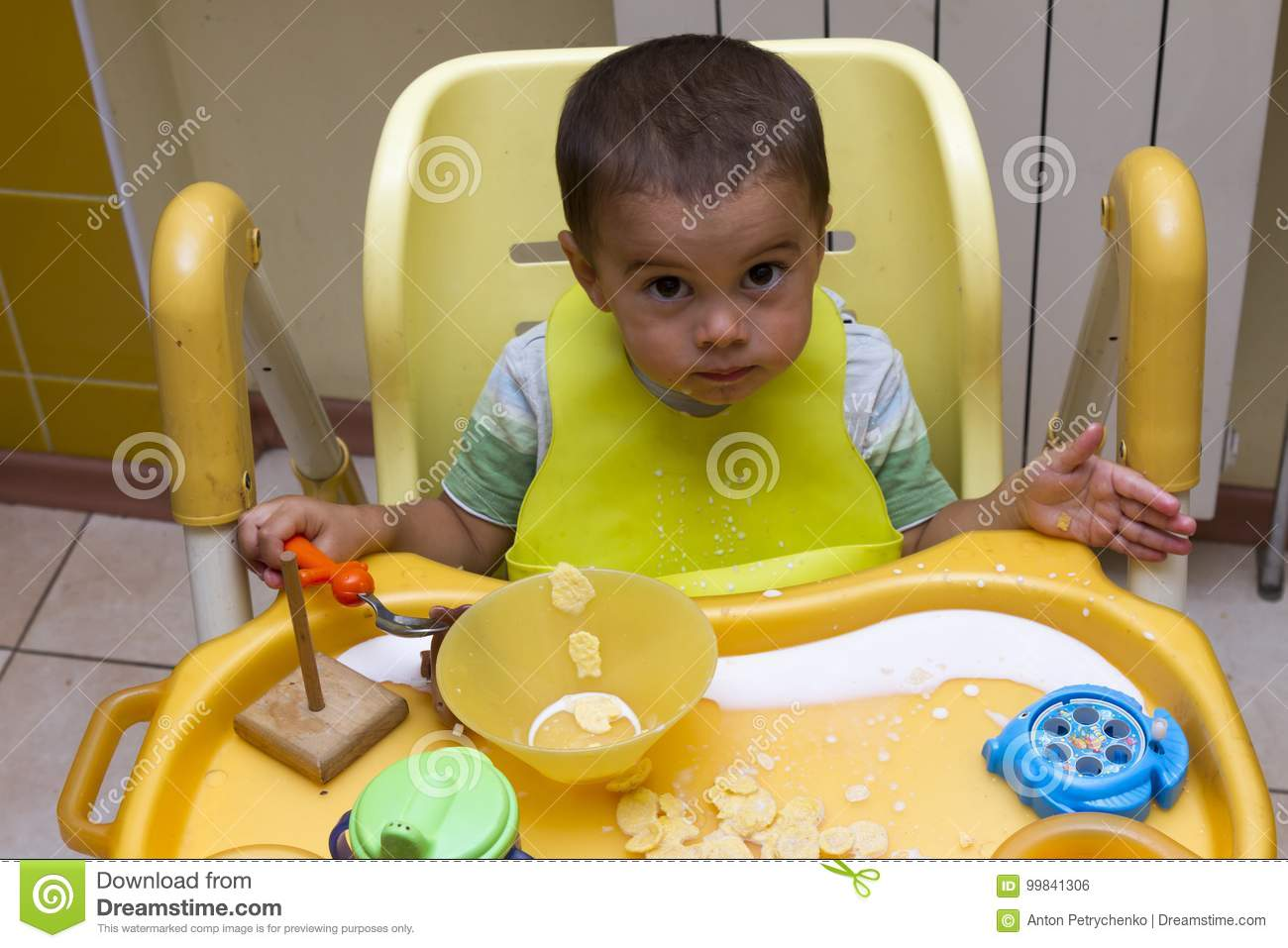 Fabulous Little One Year Old Kid Eats Porridge While Sitting In His Short Links Chair Design For Home Short Linksinfo