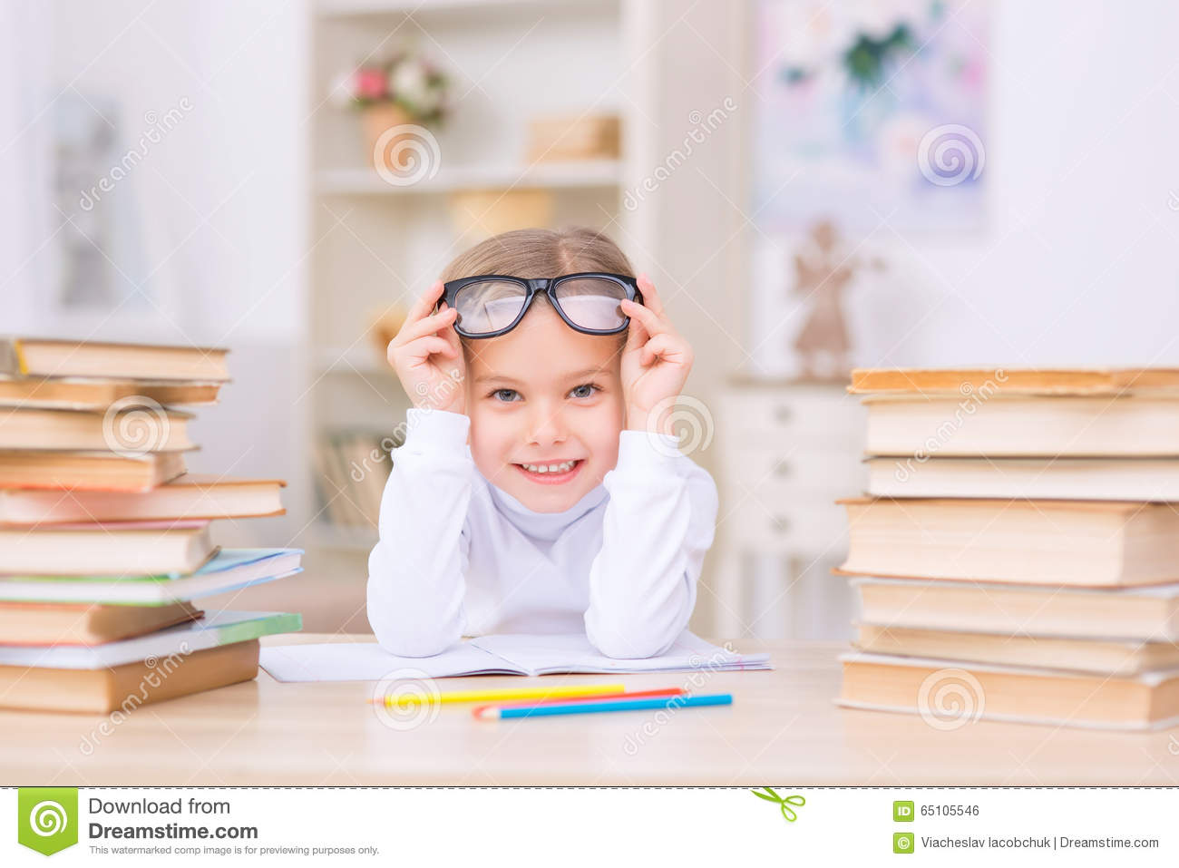 3ce5cee154 Little Positive Girl Is At The Desk With Many Stock Photo - Image of ...