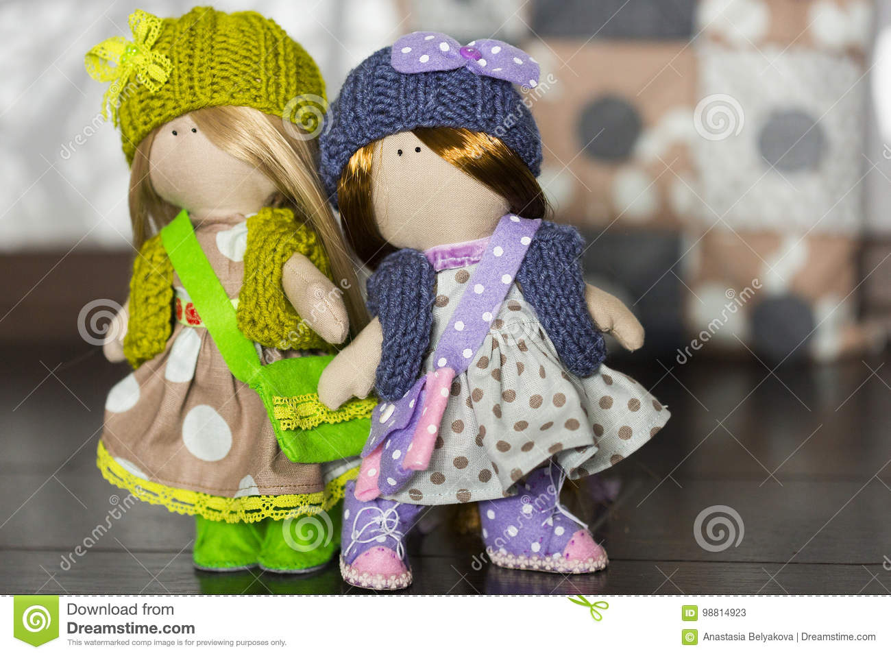 Little Rag Dolls Dressed In Polka Dot Dresses, Knitted Hats With ...