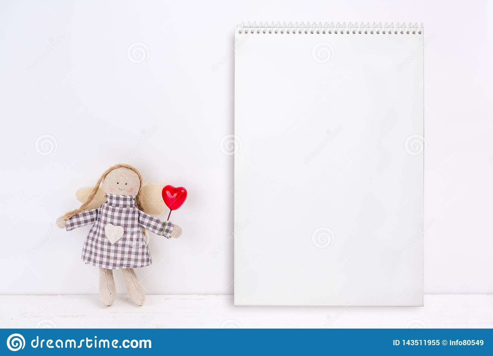 Little Puppet With A Red Heart And A Notebook Stock Image - Image of