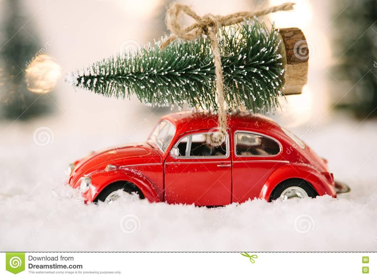 Car Christmas Tree.Little Red Car Toy Carrying Christmas Tree Stock Image