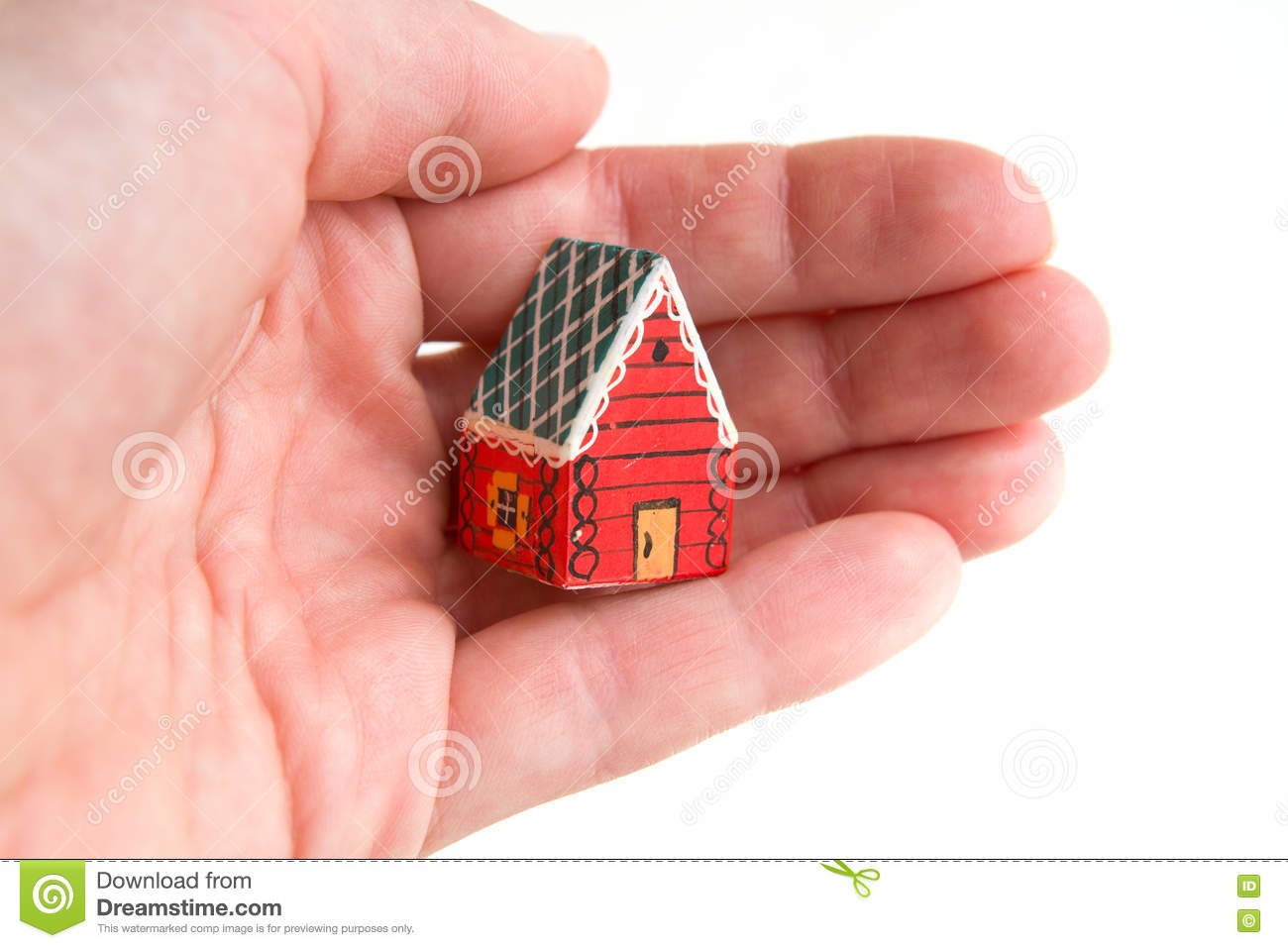 Little red house in a hand