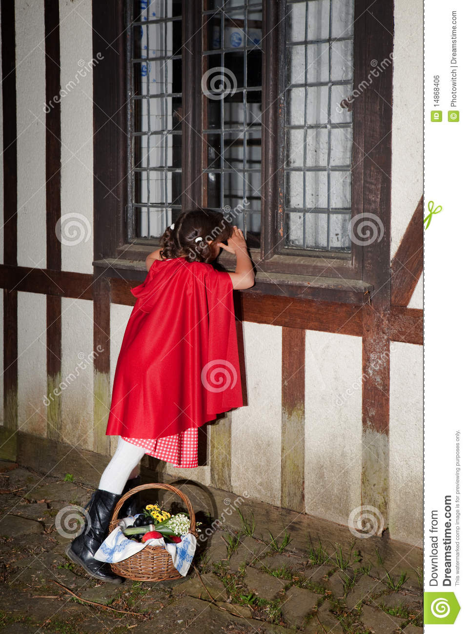 Little red riding hood looking through window