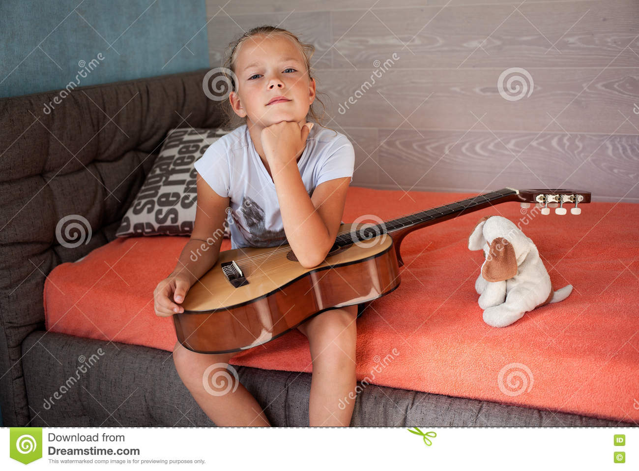 Little sad girl with a guitar