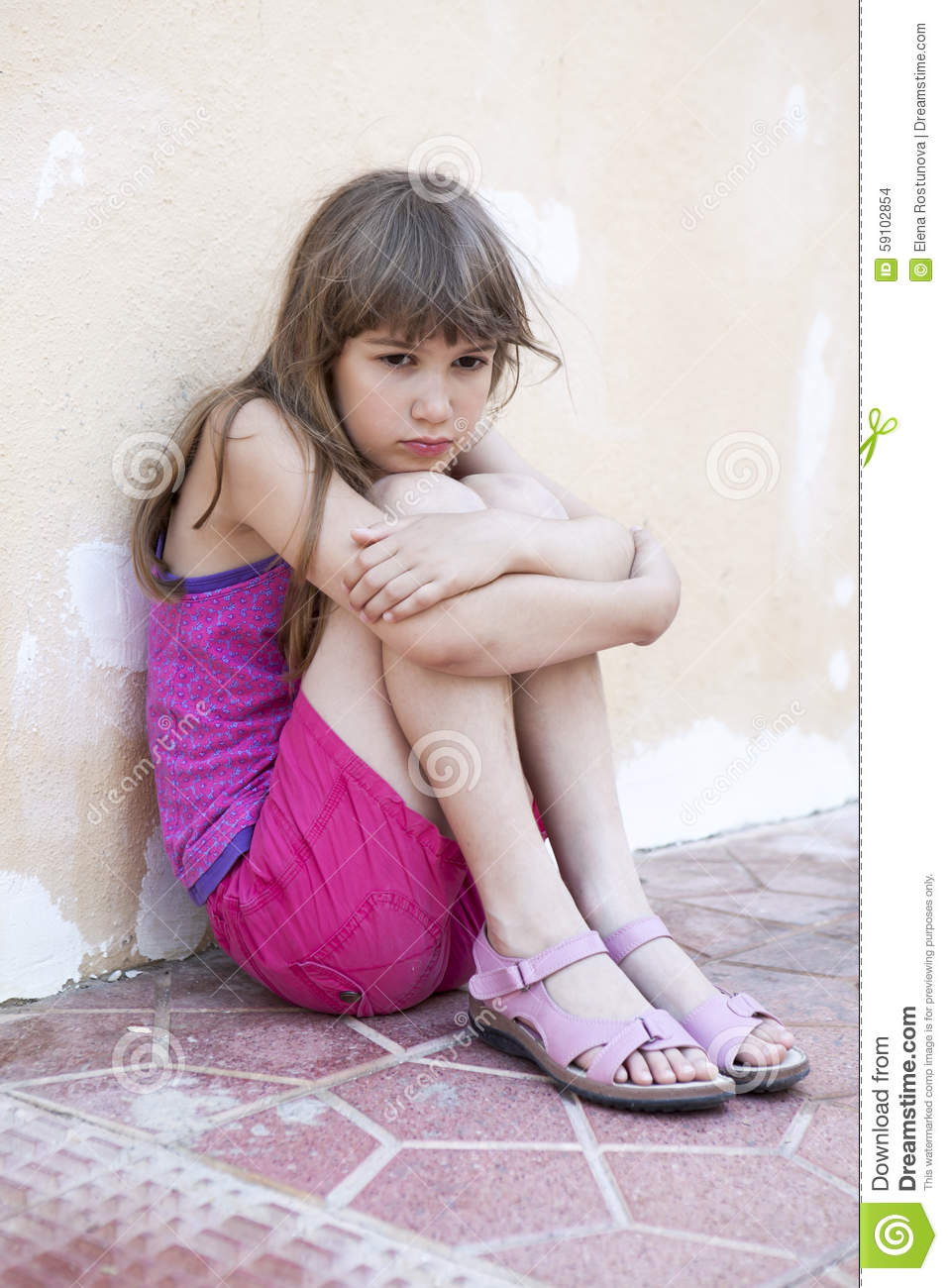 Sad Girl Sitting Alone Outside Stock Photos Sad Girl: Little Sad Girl With Long Hair Sitting Hugging Her Knees