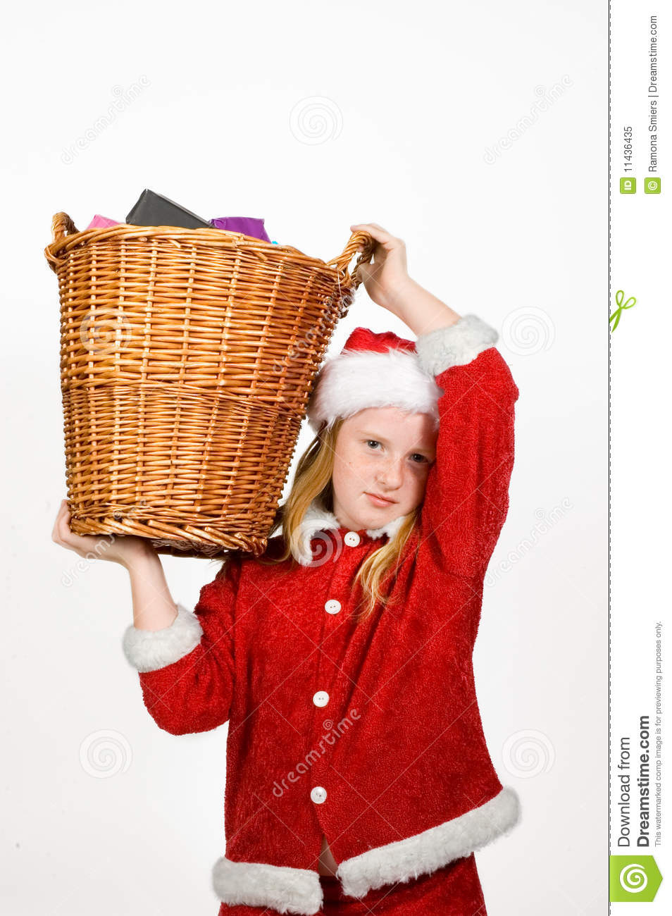 Little santa claus holding a basket royalty free stock