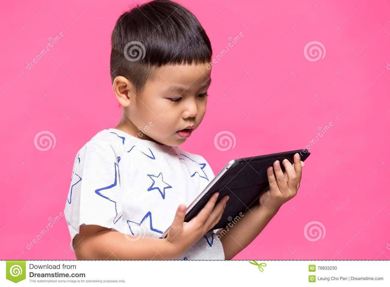 Little son watching on digital tablet