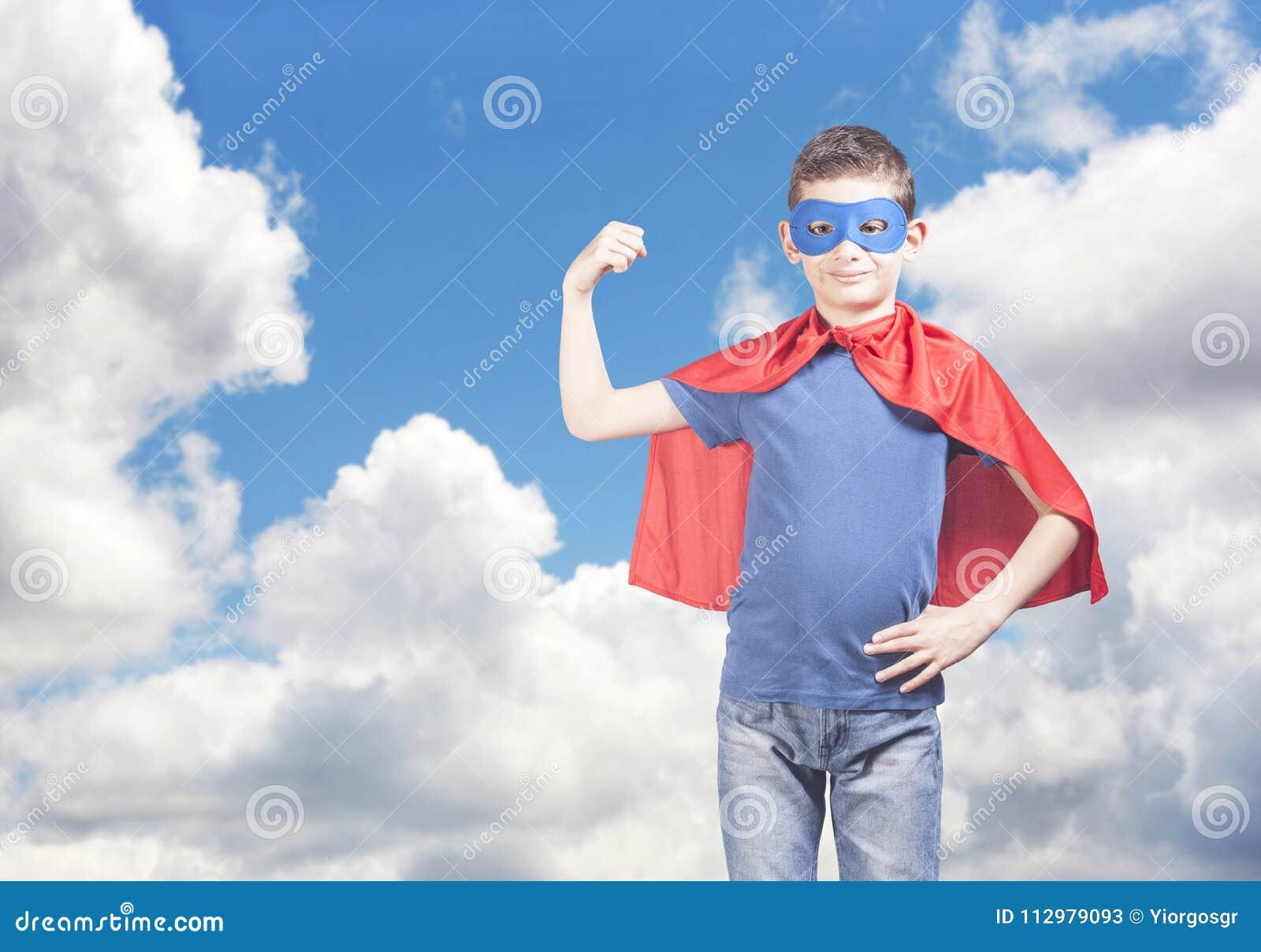 Superhero kid. Success and confidence concept