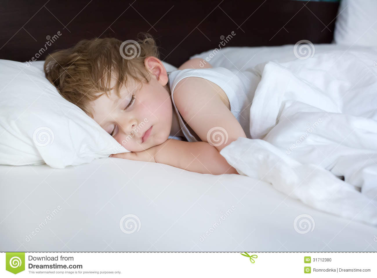 Little sweet toddler boy sleeping in his bed stock photo for Sleeping bed