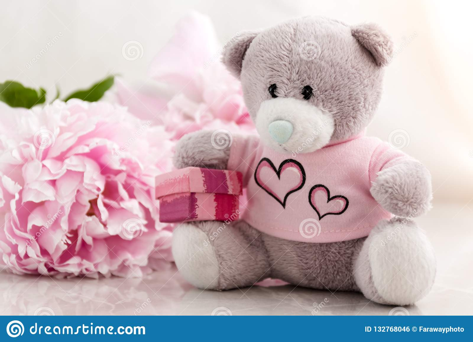 Little Teddy Bear Is Sitting With A Gift Box Stock Photo Image Of Focus Idea 132768046