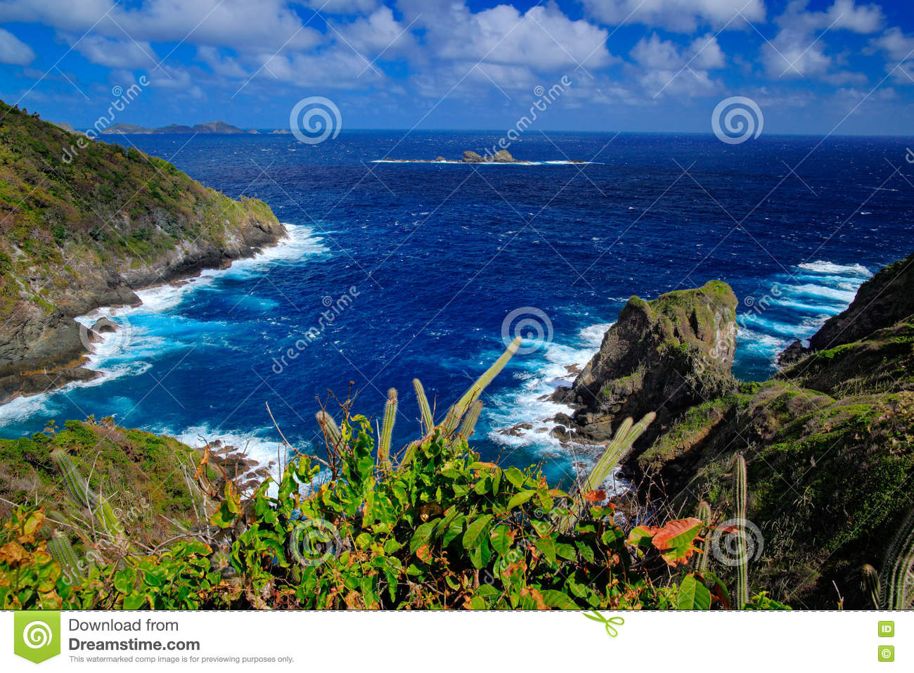 Beautiful Caribbean sea coast landscape with ocean and dark sky with white