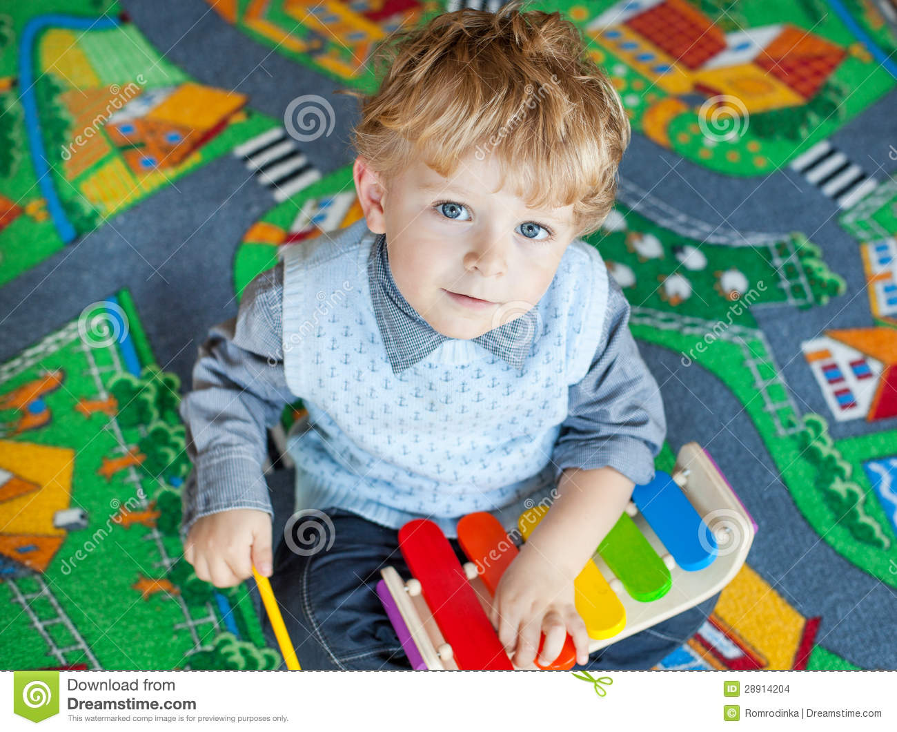Musical Toys For Toddlers Boys : Little toddler boy playing with wooden music toy stock