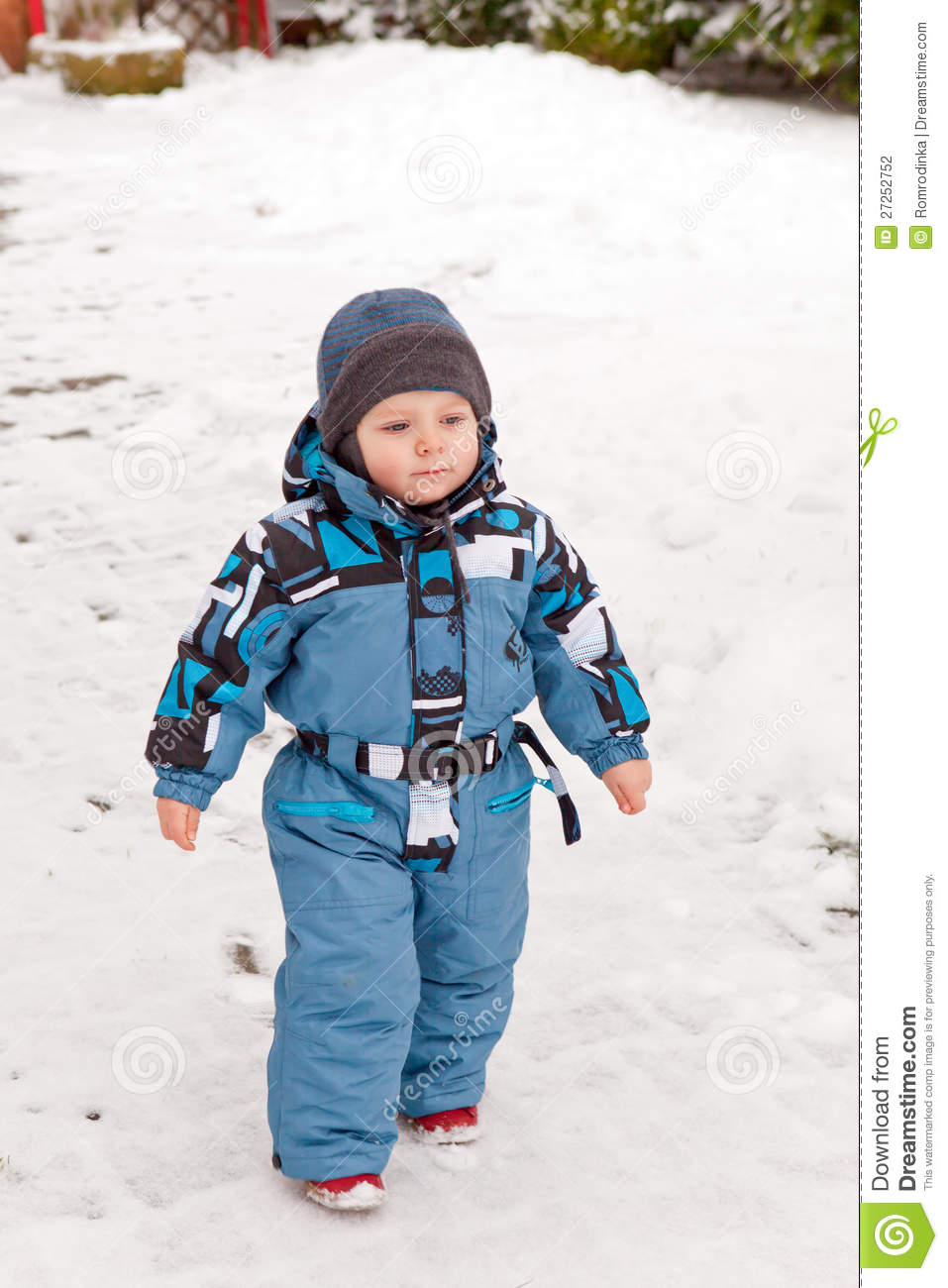 Little Toddler Playing With Snow In Winter Stock