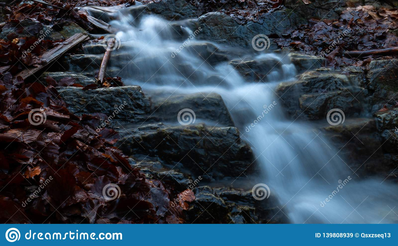 A little waterfall in the forest. In Ukraine