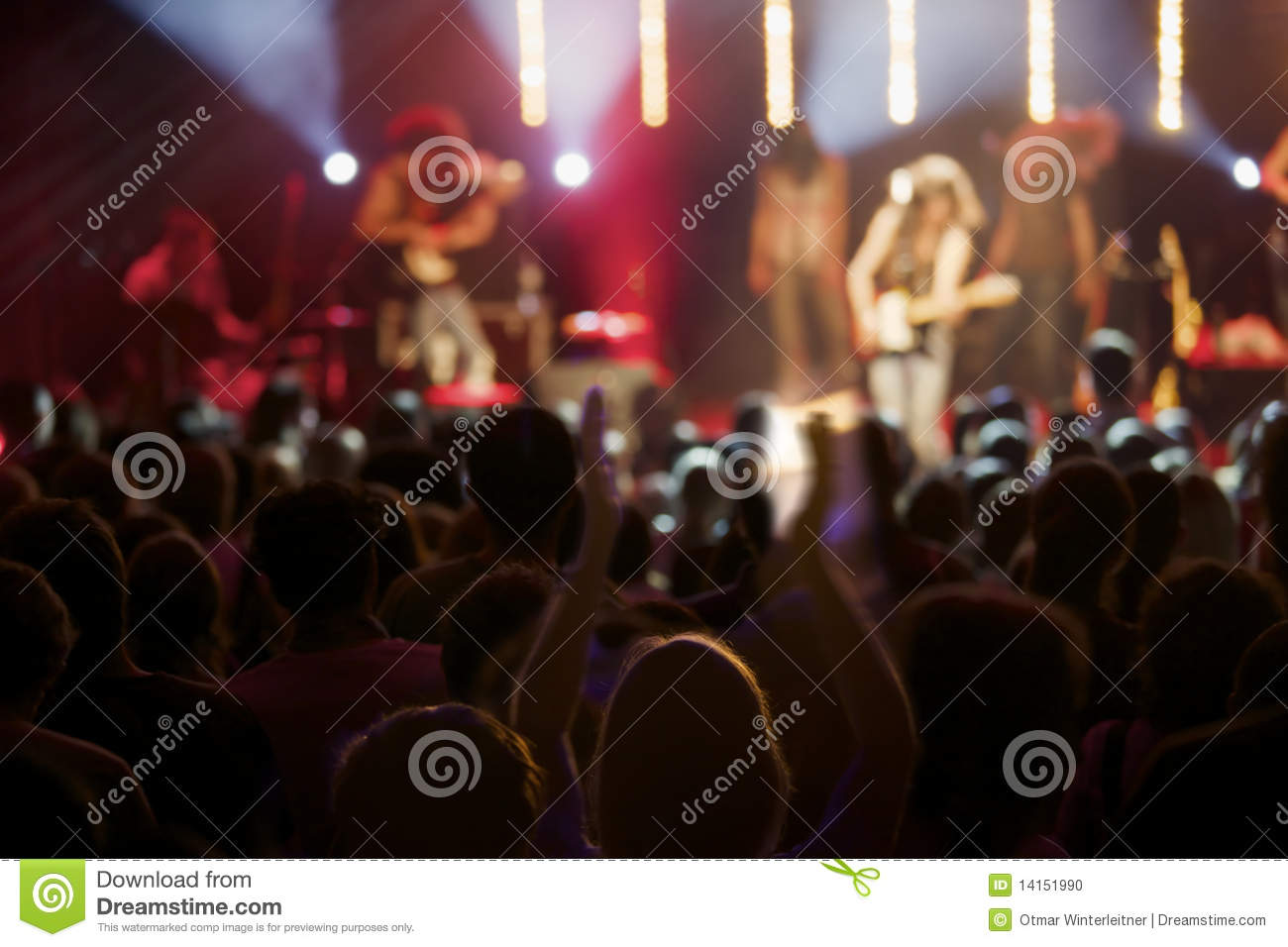Live Act Of Rock Band On Stage With Audience  Stock Photo