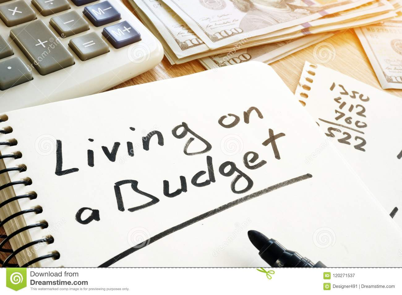living on a budget handwritten on a note home finances stock image