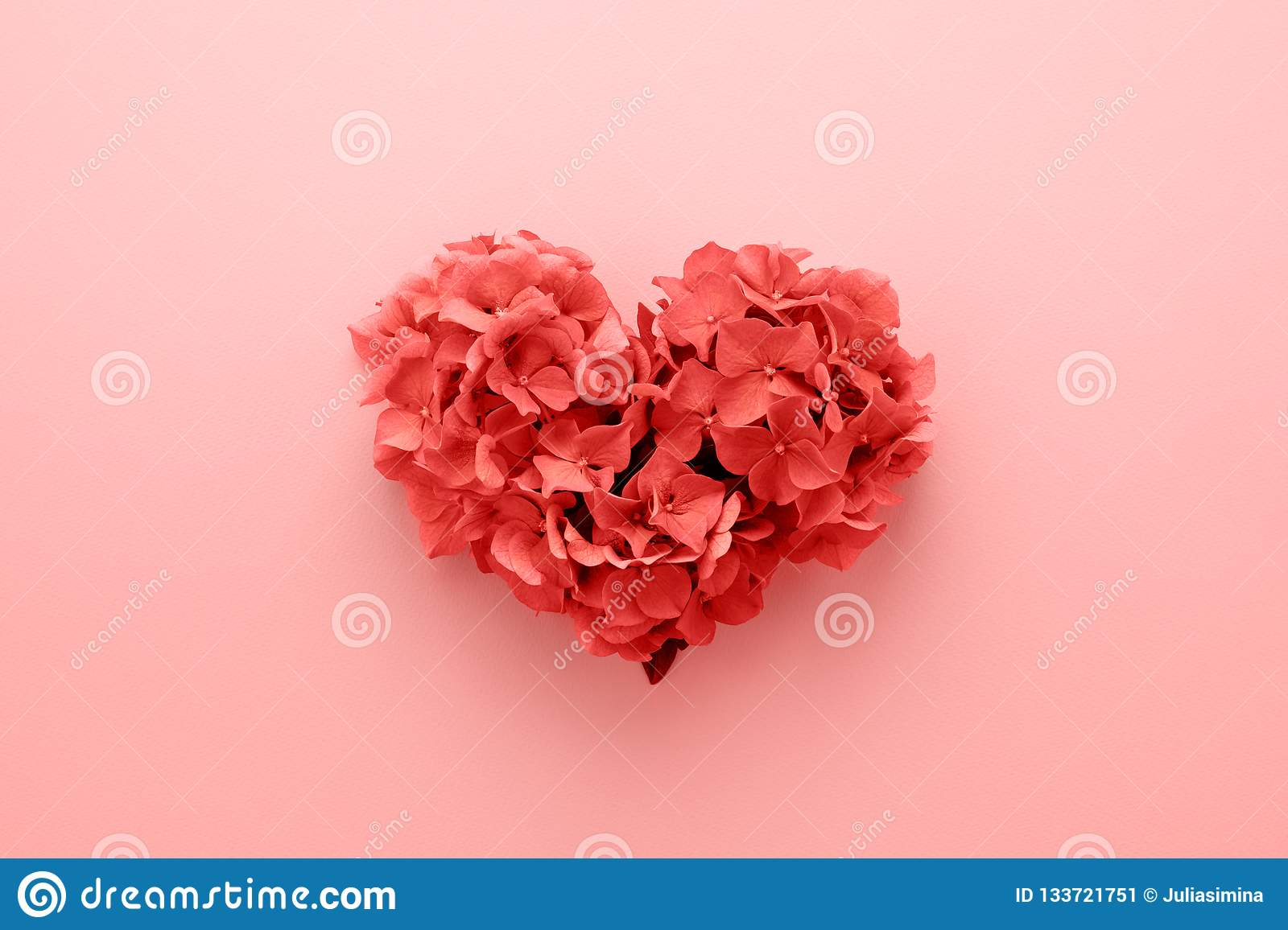 Living Coral color Heart shape made of flowers Valentine's Day