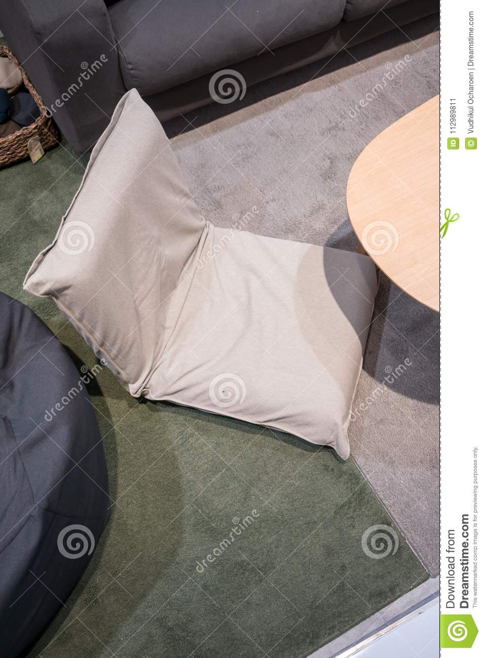 Living corner in modern style with foldable cushion on carpet.