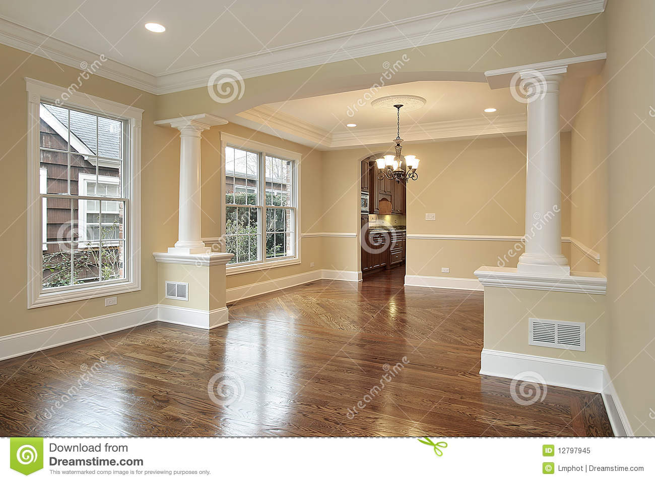 Living and dining room with white pillars royalty free for Dining room designs with pillars