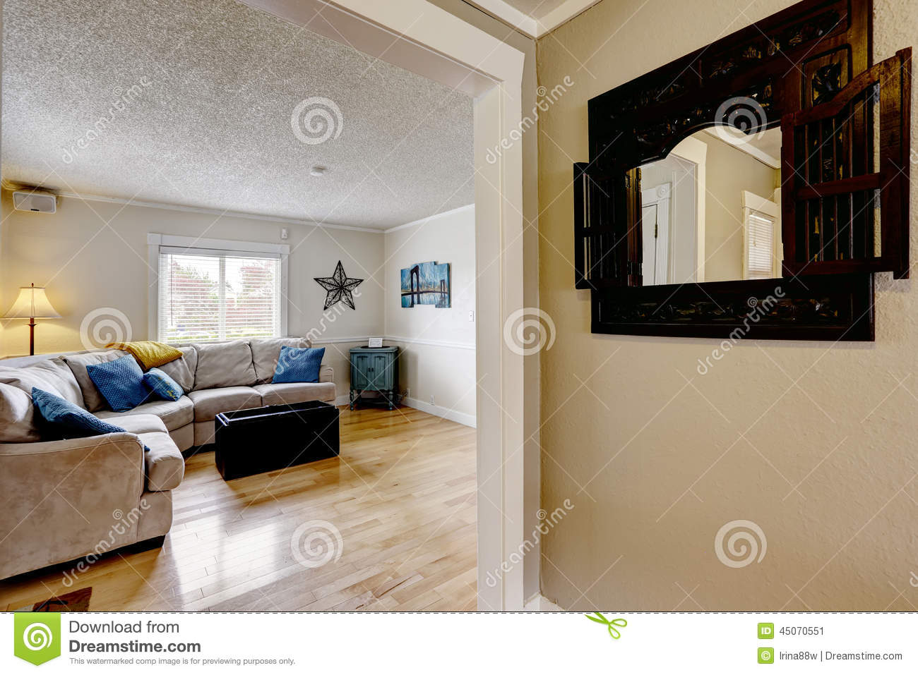 living room with beige sofa and blue pillows stock photo - image