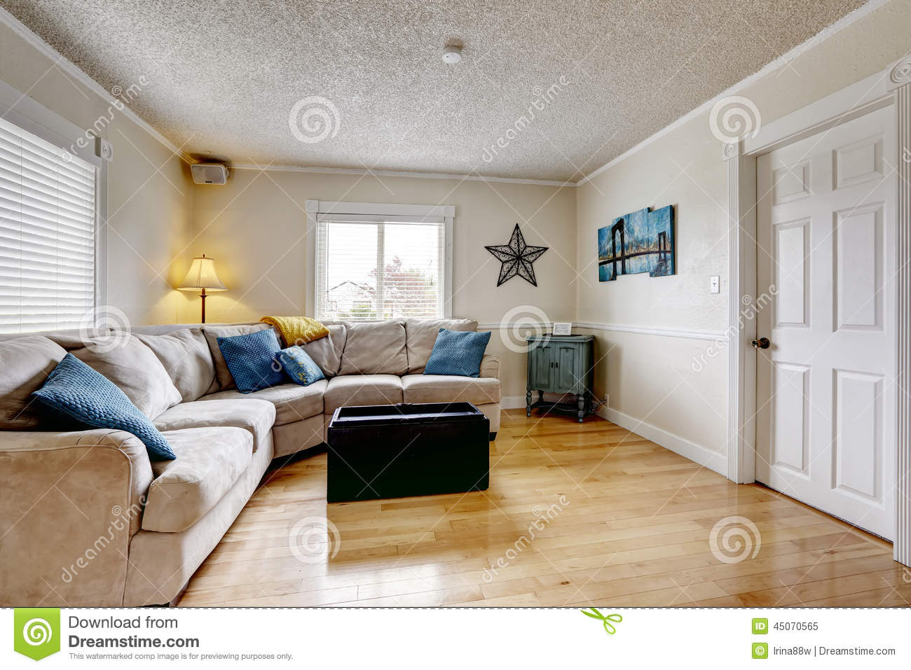 Living Room With Beige Sofa And Blue Pillows. American, Window.