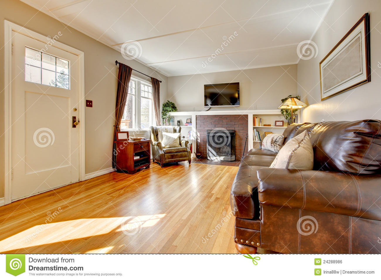 Living Room With Beige Walls, Leather Sofa And TV. Royalty Free Stock Image -...
