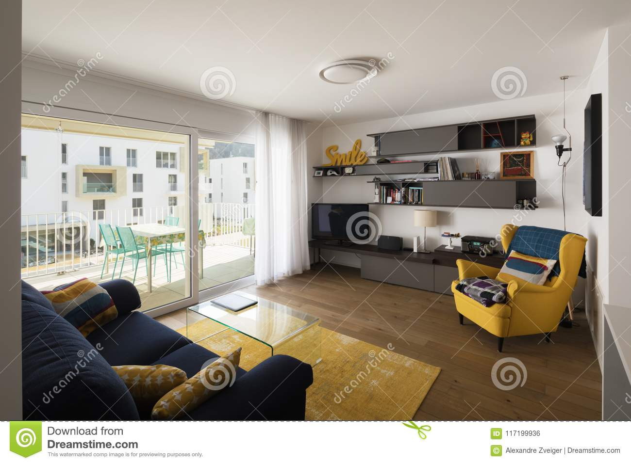 Living Room With Blue Sofa Stock Photo Image Of Yellow 117199936